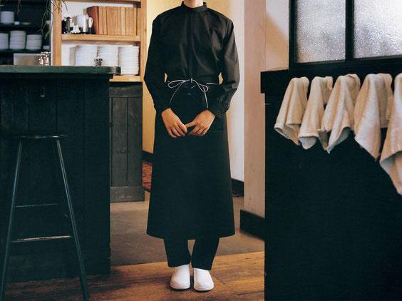 An all-black cafe uniform